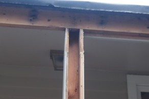 Hollow support post and exposed header beam