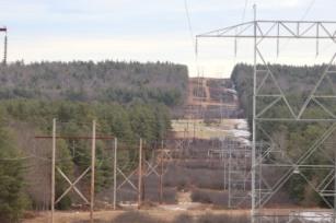High voltage power lines cross a hillside