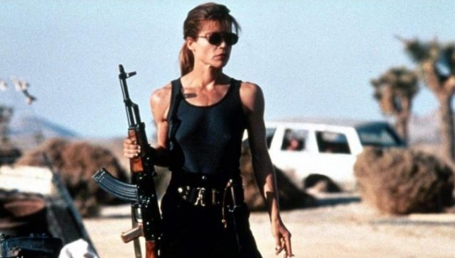Linda Hamilton holding gun and ready to fight in Terminator 2.